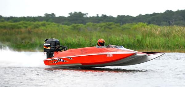 Red speed boat with outboard motot