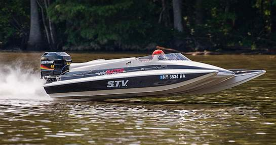 Speed boat on water with mercury outboard motor